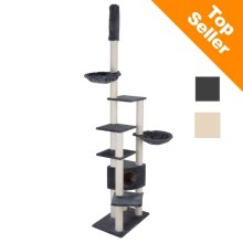 A ceiling-high plush-covered cat tree with ceiling attachment